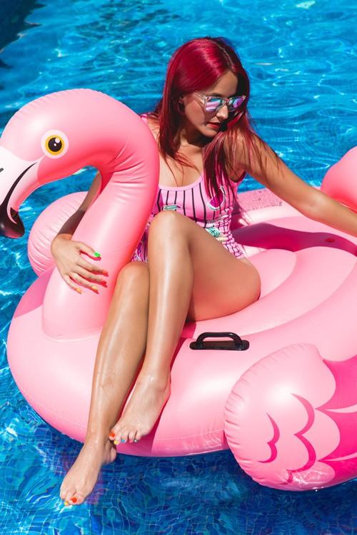 Girl on pool float